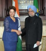 PM with President of Brazil Ms. Dilma Rousseff at Pretoria (18 October 2011)