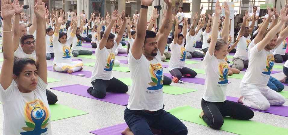 Cricket star Suresh Raina and his wife Priyanka Raina perform yoga at the event of International Day of Yoga held at The Hague, Netherlands