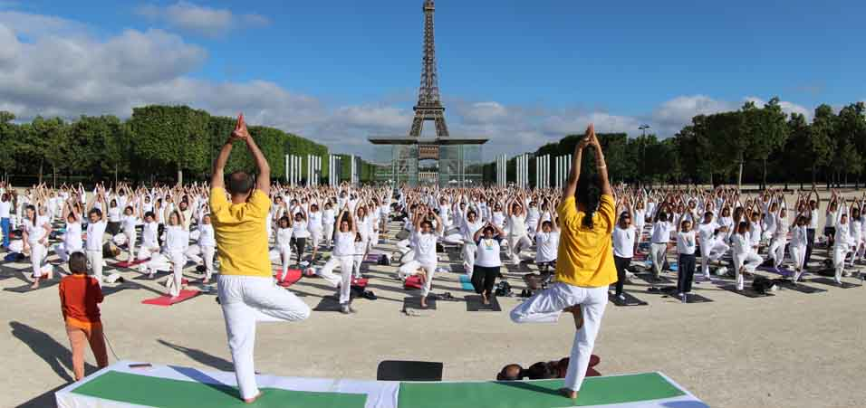 International Yoga Day 2019 celebration in front of Eiffel Tower and Wall of Peace by Embassy of India, Paris