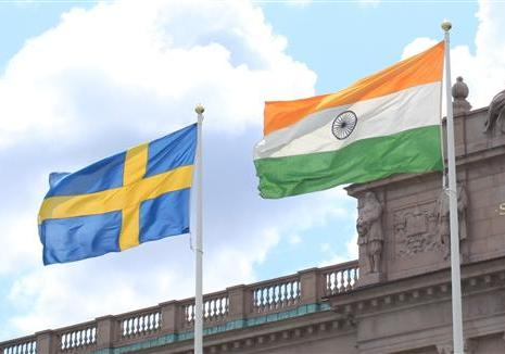 India Sweden Flags - Swedish Parliament in the back drop