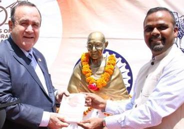 Mini bust of Mahatma Gandhi presented to President of Guatemala. Dr. Alejandro Giamma...